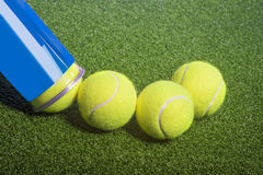Tennis concept: tennis balls out of a container Royalty Free Stock Photos