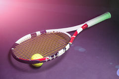 Tennis Concepts: Tennis Racket with Tennis Ball on Black backgro Stock Images