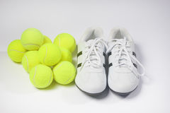 Tennis Concepts: Tennis Trainers and tennis balls against white Royalty Free Stock Image