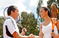 Tennis couple handshaking Stock Photos