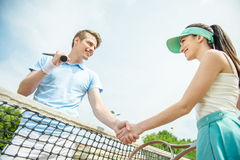 Tennis. Couple handshaking at the tennis court after a match Royalty Free Stock Photo