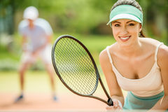 Tennis. Couple playing doubles at the tennis court. Healthy lifestyle concept Stock Photo