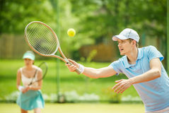 Tennis. Couple playing doubles at the tennis court. Healthy lifestyle concept royalty free stock image