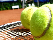 Tennis court. Balls + racket Royalty Free Stock Photography