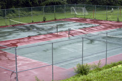 Tennis court. Empty wet tennis court on the rainy day stock images