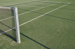 Tennis court. White lines on an outdoor tennis court (artificial grass Royalty Free Stock Images