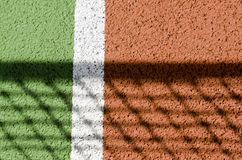 Tennis court. Net shadow on a tennis court Royalty Free Stock Image