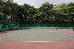 Tennis Court. A empty tennis court with trees at background Royalty Free Stock Photography