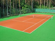 Tennis court. In coniferous wood Stock Photo