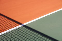 Tennis court background. Tennis court and shadow of net Royalty Free Stock Image