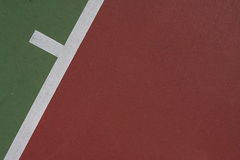 Tennis Court Background. Angled service line of a red and green tennis court for background image Stock Image
