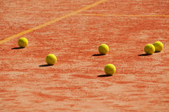 Tennis court  with balls Royalty Free Stock Image
