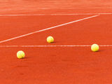 Tennis court with balls Stock Photo