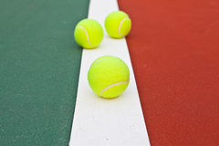 Tennis court at base line with ball Royalty Free Stock Photos