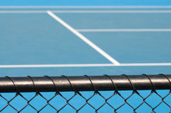 Tennis court and chain link fence Stock Photo