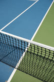 Tennis court. Close view of the net on a tennis court Royalty Free Stock Images