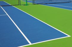 Tennis Court Closeup. Closeup of a professional tennis court for doubles in a resort community Stock Images