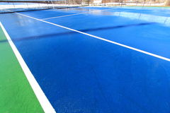 Tennis Court. Colorful tennis court in snow winter Stock Photography