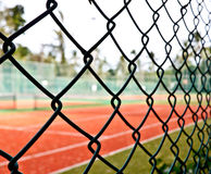 Tennis court fence Stock Photo