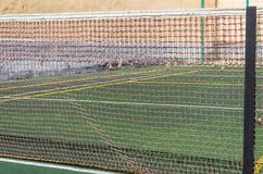Tennis court, grid and ball. stock photography