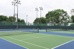 Tennis Court. With its netting boundary and lighting pole Stock Photos