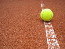 Tennis court line with ball 1. A tennis ball is on the line in the tennis court Stock Photos