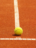 Tennis court line with ball. Outside, in the tennis court, on the t-line Stock Photos