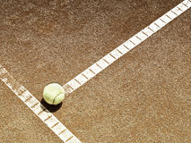 Tennis court line with ball (136). Tennis court line with ball, sepia image Royalty Free Stock Image