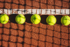 Tennis court line with balls Stock Images