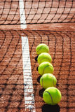 Tennis court line with balls Royalty Free Stock Photo