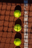 Tennis court line with balls Royalty Free Stock Photography