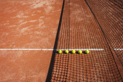 Tennis court line with balls Stock Photography