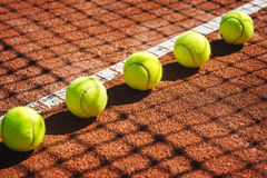 Tennis court line with balls Royalty Free Stock Images