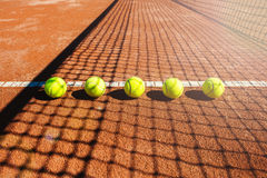 Tennis court line with balls Royalty Free Stock Photos