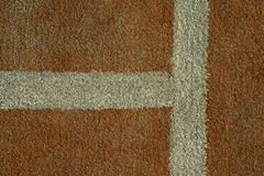 The tennis court line. Corner line on a clay tennis court Royalty Free Stock Photo