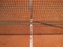 Tennis court line with net. Tennis court line with net and shadow, outside Royalty Free Stock Photo