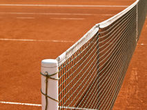 Tennis court line with net. Tennis court line with net, outside, side view Royalty Free Stock Photography