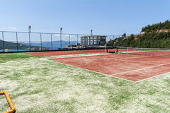 Tennis court with lines and net. Tennis court on the coast in a luxury hotel resort in Turkey Stock Photo