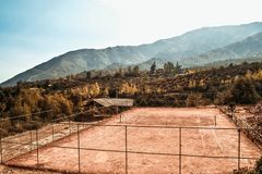 Tennis court in the mountains stock photography
