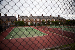 Tennis court neighborhood england houses Royalty Free Stock Photos