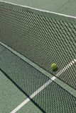 Tennis court net and ball Stock Images