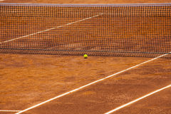 Tennis Court, Net and Ball. Stock image of an empty tennis court with net and yellow ball close to it. It is a clear sunny day and the court is ready before to Stock Image