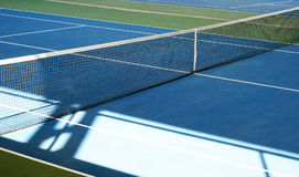 Tennis court net. Blue and green tennis court. Sport background stock photography