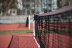 Tennis Court Net and Court Beyond Royalty Free Stock Image