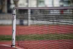 Tennis Court Net and Court Beyond Stock Photography