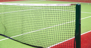 Tennis Court Net and Post. Close up picture of a tennis court net and post Royalty Free Stock Photography