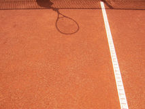 Tennis court net and racket shadow 62 Royalty Free Stock Photo