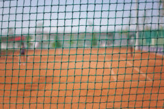 Tennis court nylon fence royalty free stock photography