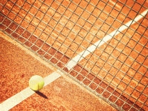 Tennis court (251). Outside in a tennis court (251) with line, tennisball and net, net in focus Royalty Free Stock Photos