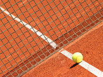 Tennis court (232). Outside in a tennis court  with line, tennisball and net - net in focus Royalty Free Stock Images